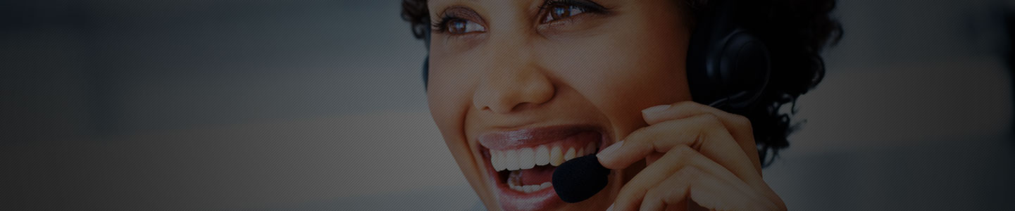 CCS Call Center Female Employee Smiling on Phone Call